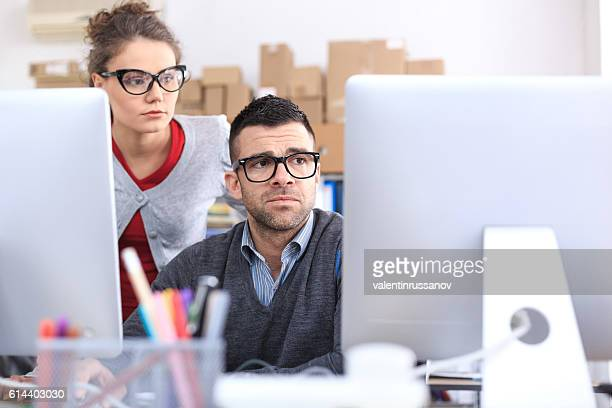 Worried office workers using computer in the office