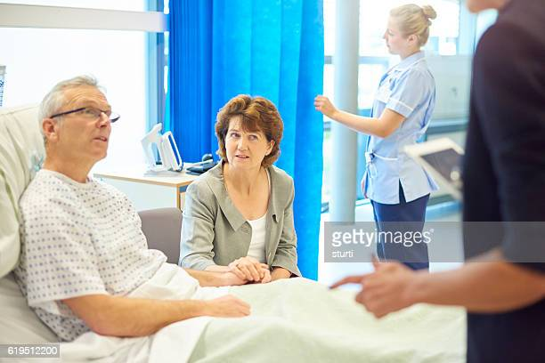worried patient and wife waiting for news