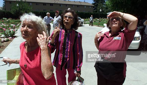 Worried residents and staff from Fickett Towers a retirement complex in Van Nuyslook at some residents who stayed in their rooms before being...