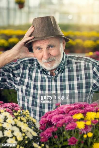 Worried senior bussinesman at greenhouse