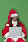 Worried Young Black Santa With Laptop