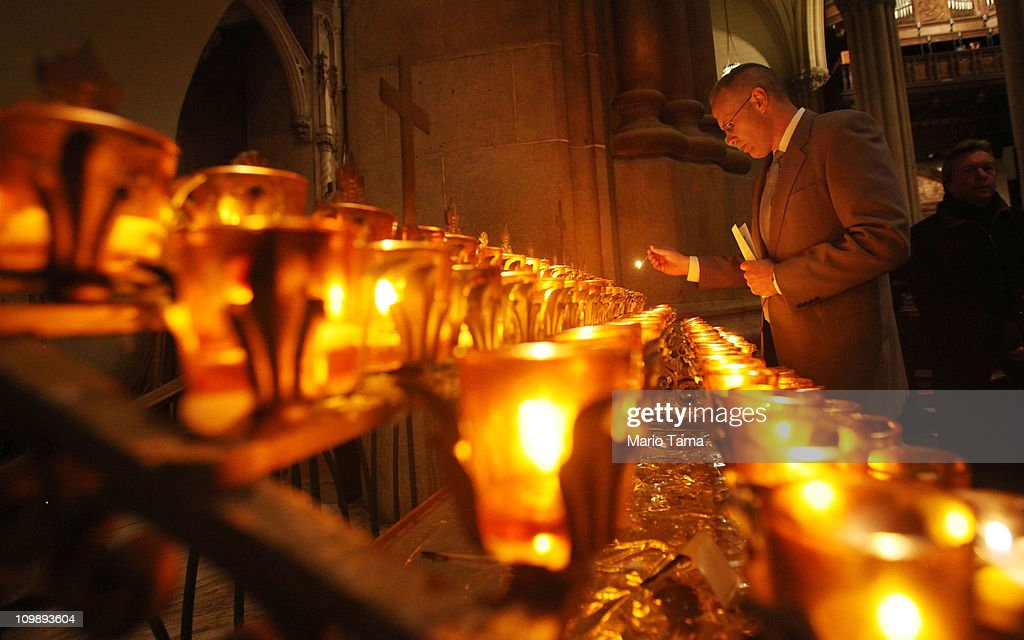 A worshiper lights a candle during Ash Wednesday services at Saint Patrick's Cathedral on March 9 2011 in New York City Ash Wednesday marks the...