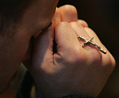 A worshiper prays April 2 2005 at Holy Name Cathedral in Chicago Illinois Francis Cardinal George OMI Archbishop of Chicago spoke about Pope John...