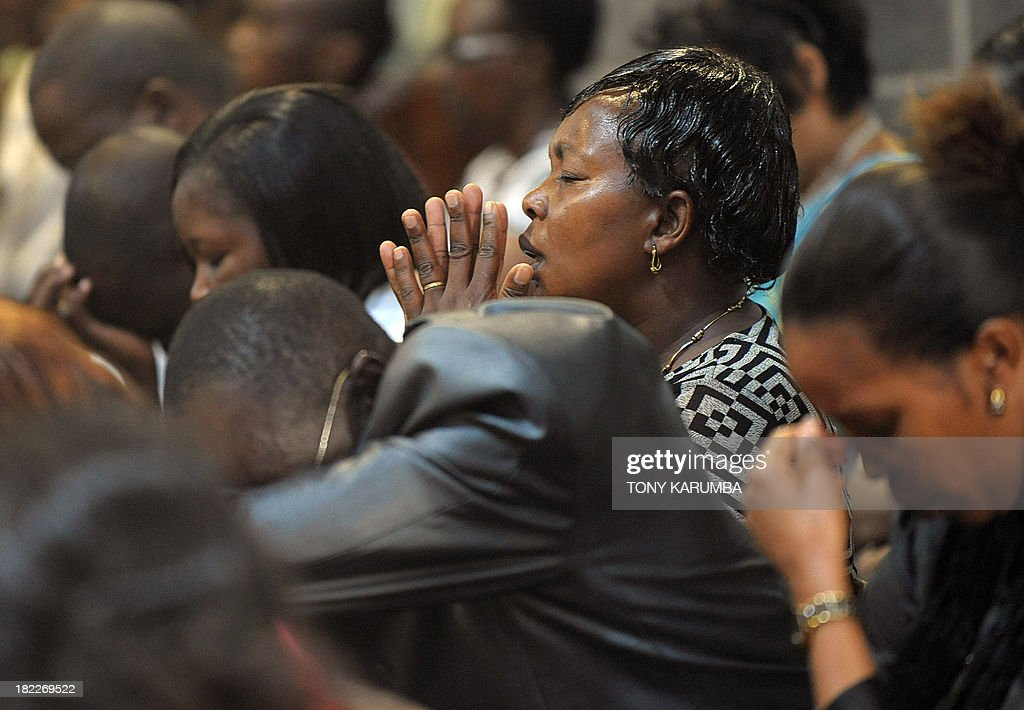 A worshiper prays at the All Saints Cathedral on September 29, 2013 during a church service. Pressure mounted on the Kenyan authorities a week after the Nairobi mall carnage amid questions over the fate of the missing and accusations on September 28, 2013 that top brass failed to heed security warnings. President Uhuru Kenyatta has vowed not to bow to the Shebab group that claimed the Westgate mall bloodbath and threatened more attacks if Kenya failed to pull its troops out of Somalia. But his administration faced tough questions after the leaking of an intelligence report dated September 13 that warned of an elevated risk, which some top officials said was treated too casually. AFP PHOTO/Tony KARUMBA