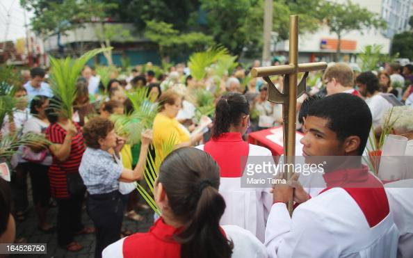 Worshipers attend an outdoor Palm Sunday Mass on March 24 2013 in Rio de Janeiro Brazil South Americans are celebrating the election of Pope Francis...