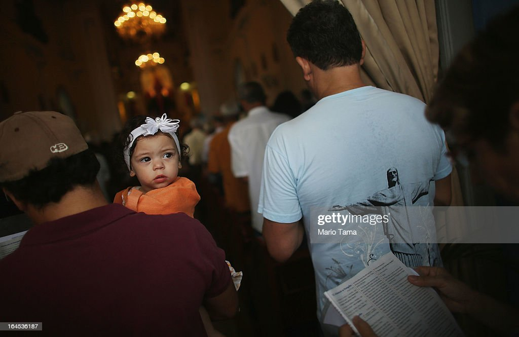 Worshipers attend Palm Sunday Mass at the Igreja de Nossa Senhora da Penha Church on March 24, 2013 in Rio de Janeiro, Brazil. South Americans are celebrating the election of Pope Francis from neighboring Argentina and Brazil holds more Catholics than any other country.