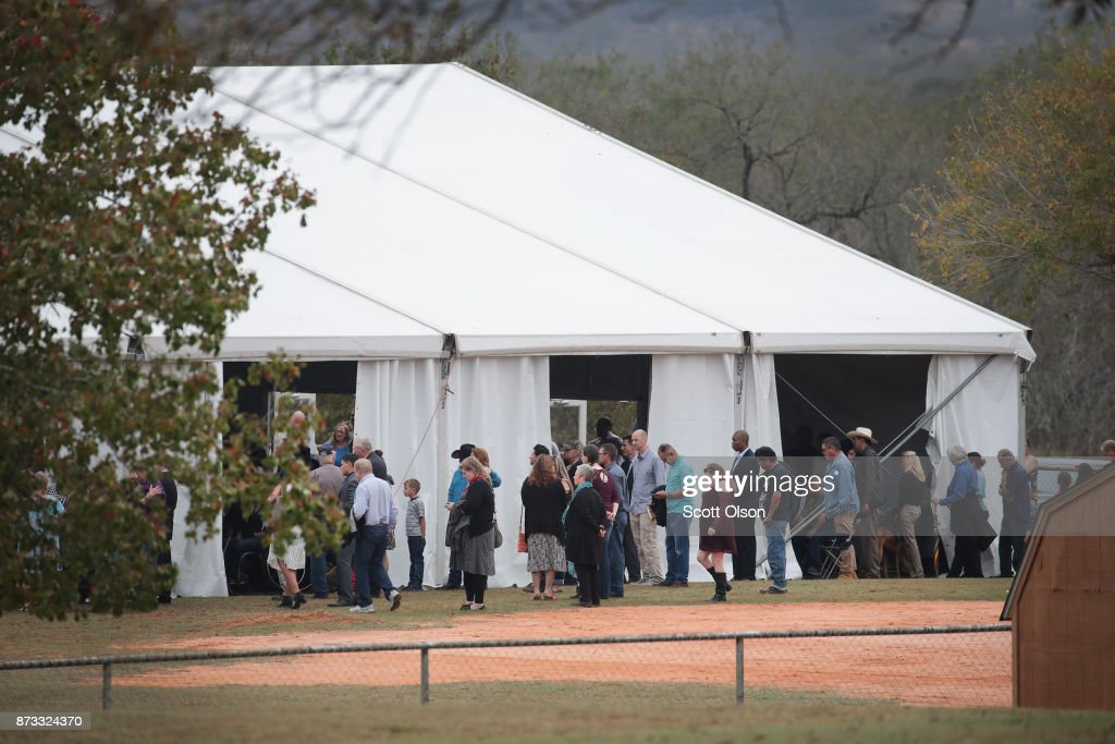 Worshipers attend service at the temporary First Baptist Church of Sutherland Springs on November 12, 2017 in Sutherland Springs, Texas. The service was held in a tent on the site of the town's baseball field. Residents of the community are still trying to heal following the shooting at the original church building on November 5. Devin Patrick Kelley shot and killed the 26 people and wounded 20 others when he opened fire during Sunday service at the church.