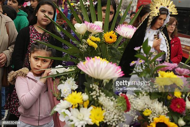 Worshipers carry a statue of Mary the mother of Jesus Christ during the Via Crusis or 'Way of the Cross' to mark Good Friday April 3 2015 in...