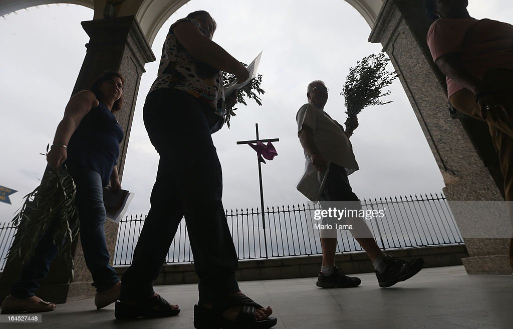 Worshipers carry palms outside the Igreja de Nossa Senhora da Penha Church before Palm Sunday Mass on March 24, 2013 in Rio de Janeiro, Brazil. South Americans are celebrating the election of Pope Francis from neighboring Argentina and Brazil holds more Catholics than any other country.