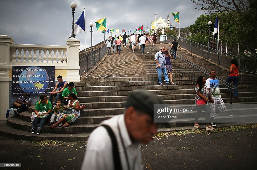 Worshipers climb and descend steps near the Nossa Senhora da Penha Church on the final day of the annual October feast of the patron saint marking the 378th anniversary of the church on October 27, 2013 in Rio de Janeiro, Brazil. Pilgrims often climb the entire 382 steps that lead to the church, originally constructed in 1635, which is perched on a rocky hill. Brazil holds more Catholics than any other country.
