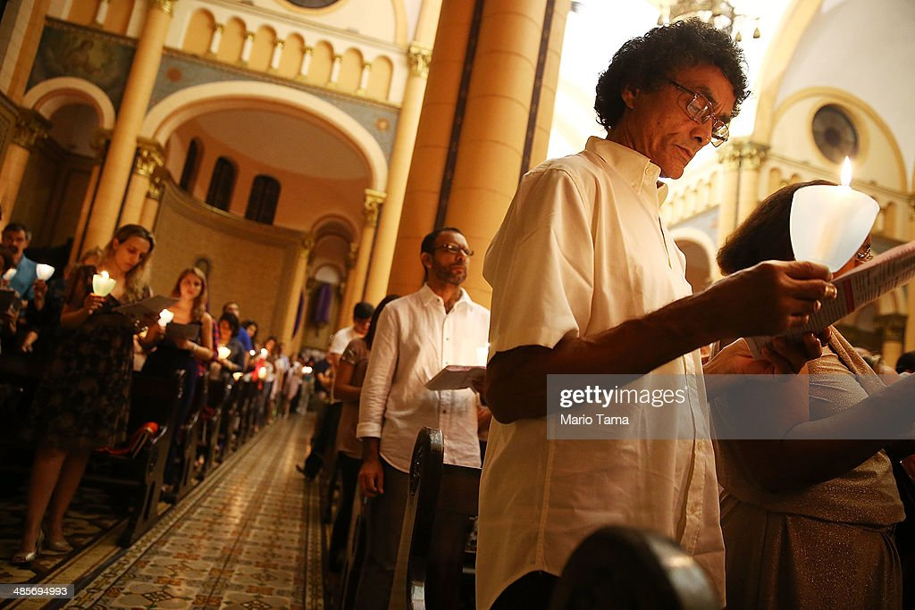 Worshipers gather during Semana Santa (Holy Week) services in Paroquia Nossa Senhora da Paz on April 19, 2014 in Rio de Janeiro, Brazil. Holy Week marks the last week of Lent and the beginning of Easter celebrations for Catholics. Brazil holds more Catholics than any other country.
