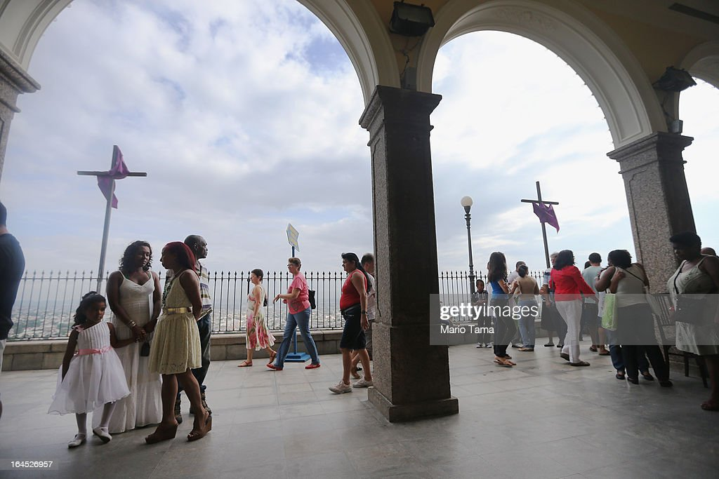 Worshipers gather outside the Igreja de Nossa Senhora da Penha Church between Palm Sunday Masses on March 24, 2013 in Rio de Janeiro, Brazil. South Americans are celebrating the election of Pope Francis from neighboring Argentina and Brazil holds more Catholics than any other country.
