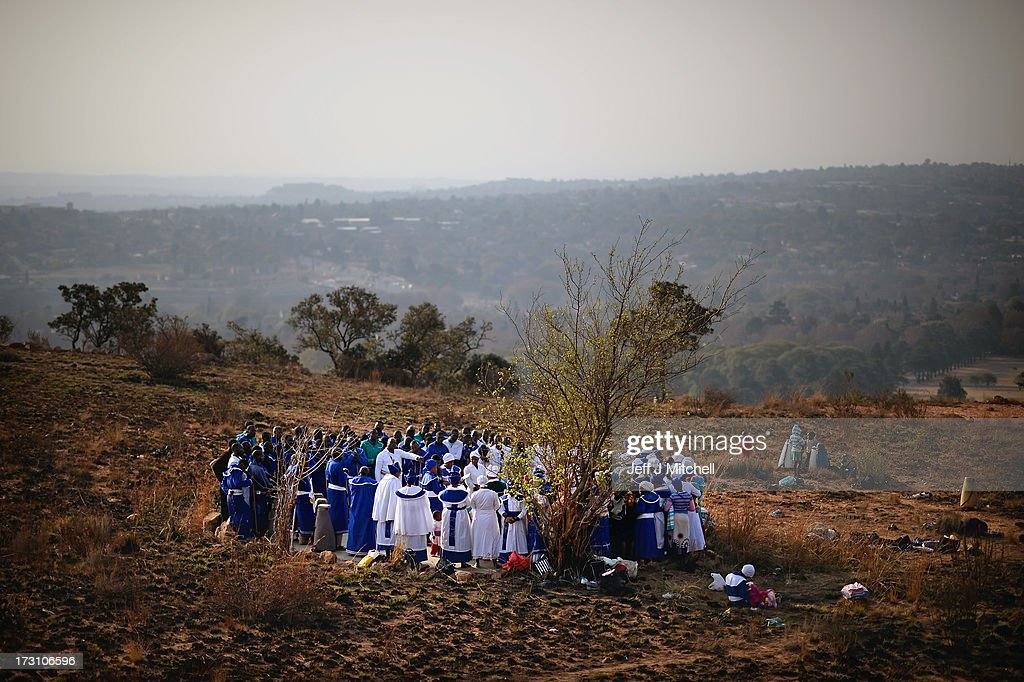 Worshipers gather to hold church services and prayers on top of Melville Koppies on June 7, 2013 in Johannesburg, South Africa. Former South African President Nelson Mandela has been hospitalized at the Medi-Clinic Hospital in Pretoria since June 8 for treatment for a recurring lung infection.