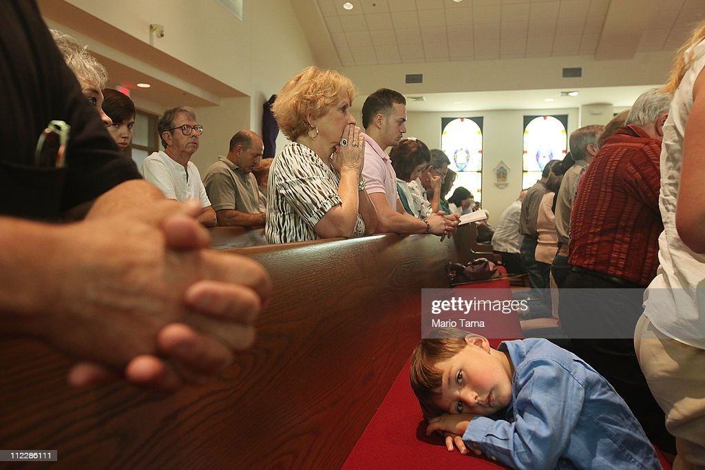 Worshipers pray inside St. Clare Catholic Church, which was completely destroyed by Hurricane Katrina and rebuilt, April 17, 2011 in Waveland, Mississippi. Animals are still washing up on beaches in high numbers in Mississippi, which continues to be impacted by tar balls and weathered oil. April 20th marks the one-year anniversary of the worst environmental disaster in U.S. history.