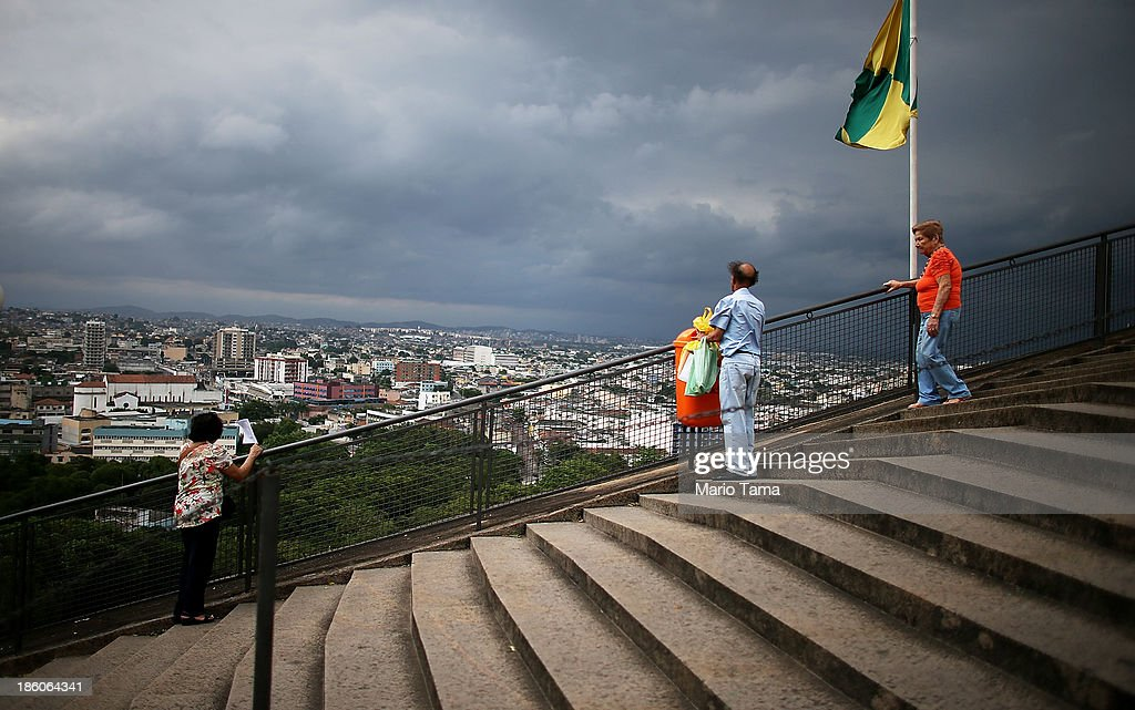 Worshipers view the city from steps leading to the Nossa Senhora da Penha Church on the final day of the annual October feast of the patron saint marking the 378th anniversary of the church on October 27, 2013 in Rio de Janeiro, Brazil. Pilgrims often climb the entire 382 steps that lead to the church, originally constructed in 1635, which is perched on a rocky hill. Brazil holds more Catholics than any other country.