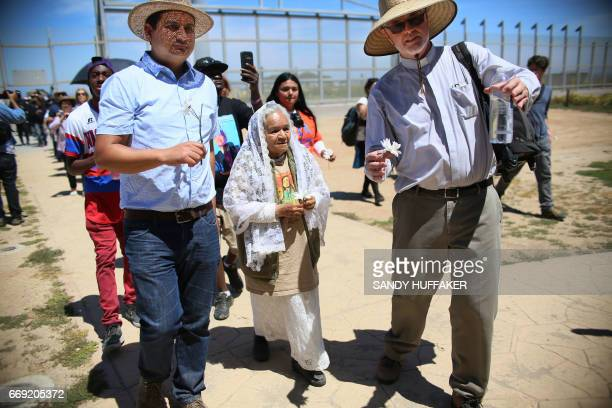 Worshipers walk to the border fence before participating in a binational Easter mass along the USMexico border fence at Friendship Park in San Ysidro...