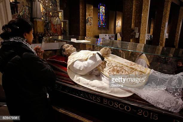 Worshiping Saint John Boscos reliquary
