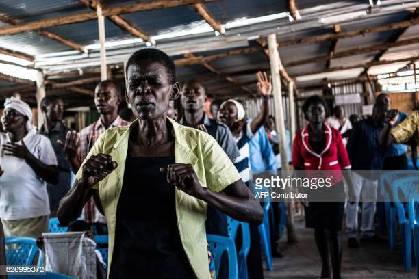 A worshipper attends a service at the Voice of the Potter's Messenger Church on August 6 2017 located at the entrance to Obunga slum in Kenya'a...