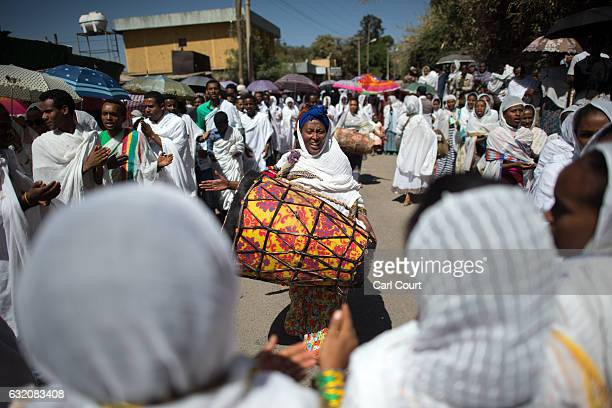 A worshipper bangs a drum during a procession to mark the annual Timkat epiphany celebration on January 18 2017 in Gondar Ethiopia Timkat is the...