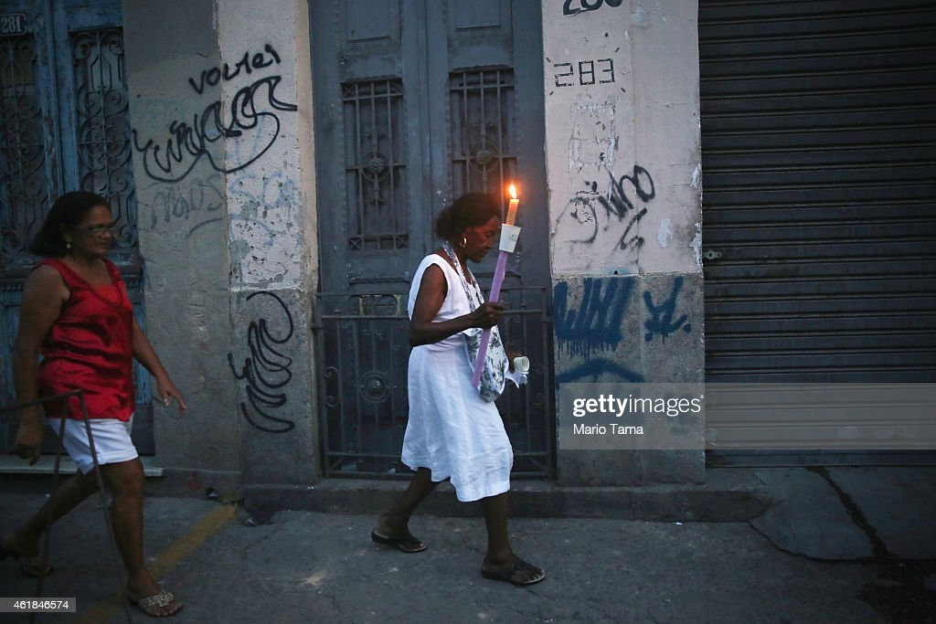 A worshipper carries a candle while marching in a procession marking the day of Saint Sebastian, the patron saint of Rio, on January 20, 2015 in Rio de Janeiro, Brazil. Brazil is home to more Catholics than any other country in the world..