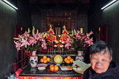 A worshipper in Tin Hau Temple in Nga Tsin Wai village which is to be demolished as part of a city reurbanisation plan in Wong Tai Sin District on...