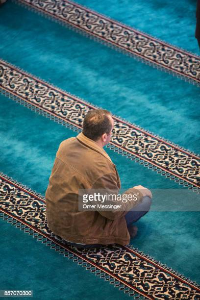 Worshipper is seen during midday prayers at Sehitlik mosque which is mostly Turkish on Open Mosque Day on October 3 2017 in Berlin Germany Hundreds...