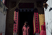 A worshipper walks out of the Tin Hau Temple in Nga Tsin Wai village which is to be demolished as part of a city reurbanisation plan in Wong Tai Sin...
