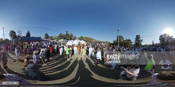 Worshippers and Ethiopian Orthodox priests takes part in a procession to mark the annual Timkat epiphany celebration on January 18 2017 in Gondar...