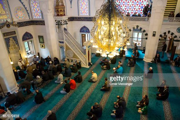 Worshippers are seen during midday prayers at Sehitlik mosque which is mostly Turkish on Open Mosque Day on October 3 2017 in Berlin Germany Hundreds...