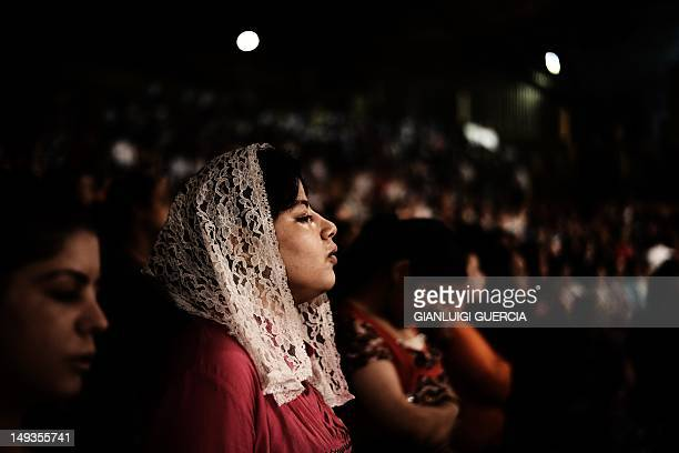 Worshippers attend a service as Coptic priest Father Samaan Ibrahim reads his sermon on July 26 2012 at the St Samaans Church also known as the Cave...