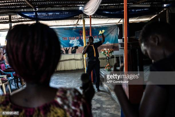 Worshippers attend a service at the Voice of the Potter's Messenger Church on August 6 2017 located at the entrance to Obunga slum in Kenya'a...