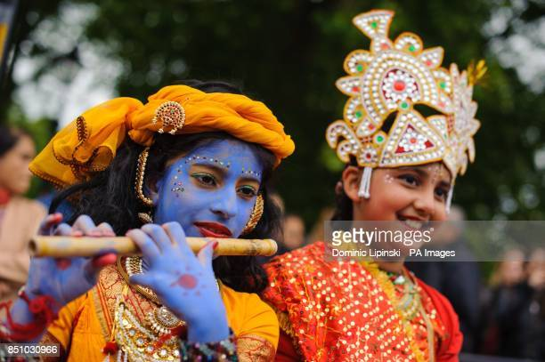 Worshippers attend the Hare Krishna Rathayatra Festival of Chariots in Hyde Park central London
