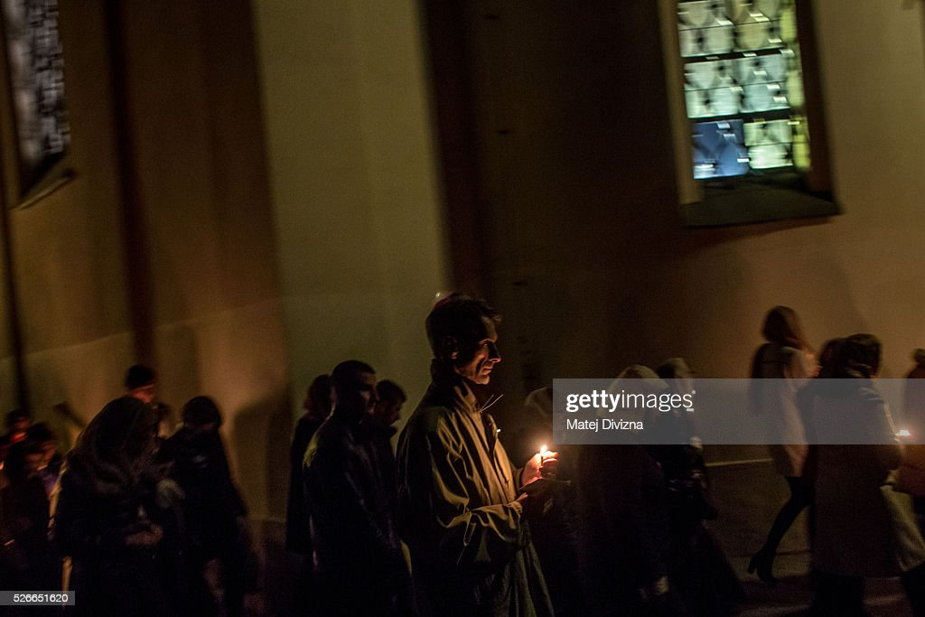 Worshippers carry candles as they walk around the Orthodox Church of the Dormition during the Orthodox Easter ceremony at the Olsany Cemetery on May 1, 2016 in Prague, Czech Republic. The Greek Orthodox world celebrates Easter Day according to the old Julian calendar.