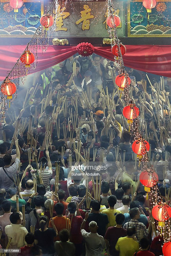 Worshippers gather at Kwan Im Thong Hood Cho Temple on Lunar New Year to offer prayers and place joss sticks on February 10, 2013 in Singapore. Thousands gathered today to celebrate the Chinese New Year and welcome the the Year of the Snake, with new year's day falling on February 10. Chinese new Year is the most important festival in the Chinese calendar and is celebrated in Singapore and many other Southeast Asian countries with significant Chinese Populations.