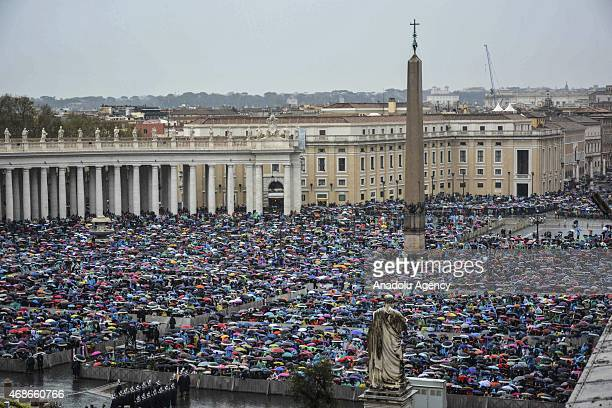 Worshippers gather at St Peter's Square as Pope Francis celebrates the Easter Mass in Vatican City on April 5 2015 Thousands of worshippers from...