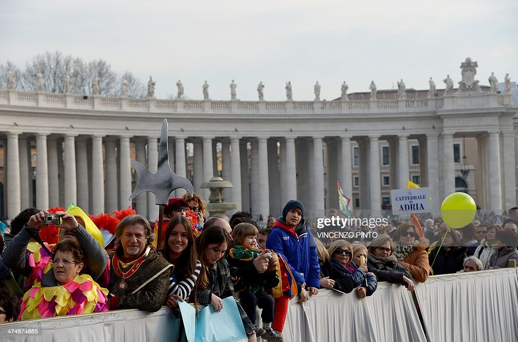 Worshippers gather beside the colonnade in Saint Peter's square at the Vatican during Pope Francis' general audience on February 26, 2014. Scaffolding around the famous 17th-century marble colonnade on St Peter's Square designed by architect and sculptor Gian Lorenzo Bernini was taken down this week following a five-year restoration. The columns around the Vatican square where Pope Francis addresses pilgrims have regained their original splendour -- in time for the sainthood ceremony for late popes John Paul II and John XXIII in April.
