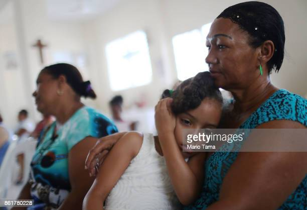 Worshippers gather during Sunday mass in a church without electricity on October 15 2017 in San Isidro Puerto Rico Puerto Rico is suffering shortages...