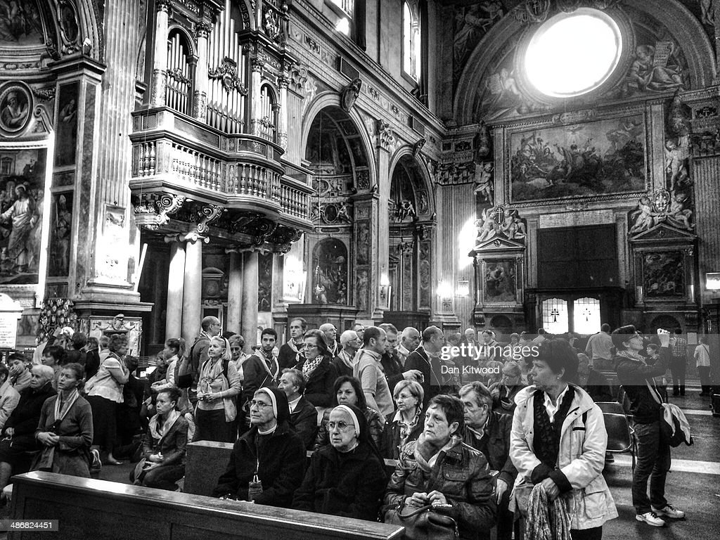 Worshippers gather inside the Polish Church, Santo Spirito in Sassia, Sanctuary of Divine Mercy on April 26, 2014 in Vatican City, Vatican. Dignitaries, heads of state and Royals, from Europe and across the World, are gathering in the Vatican ahead of tomorrow's canonisations. The late Pope John Paul II and Pope John XXIII will be canonised on Sunday 27 April, inside the Vatican when 800,000 pilgrims from around the world are expected to attend.