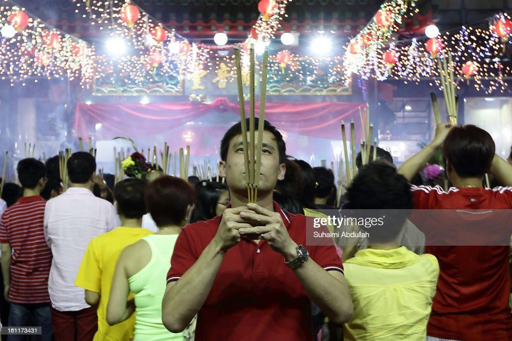 Worshippers gather to pray at the Kwan Im Thong Hood Cho Temple on Lunar New Year on February 10, 2013 in Singapore. Thousands gathered today to celebrate the Chinese New Year and welcome the the Year of the Snake, with new year's day falling on February 10. Chinese new Year is the most important festival in the Chinese calendar and is celebrated in Singapore and many other Southeast Asian countries with significant Chinese Populations.