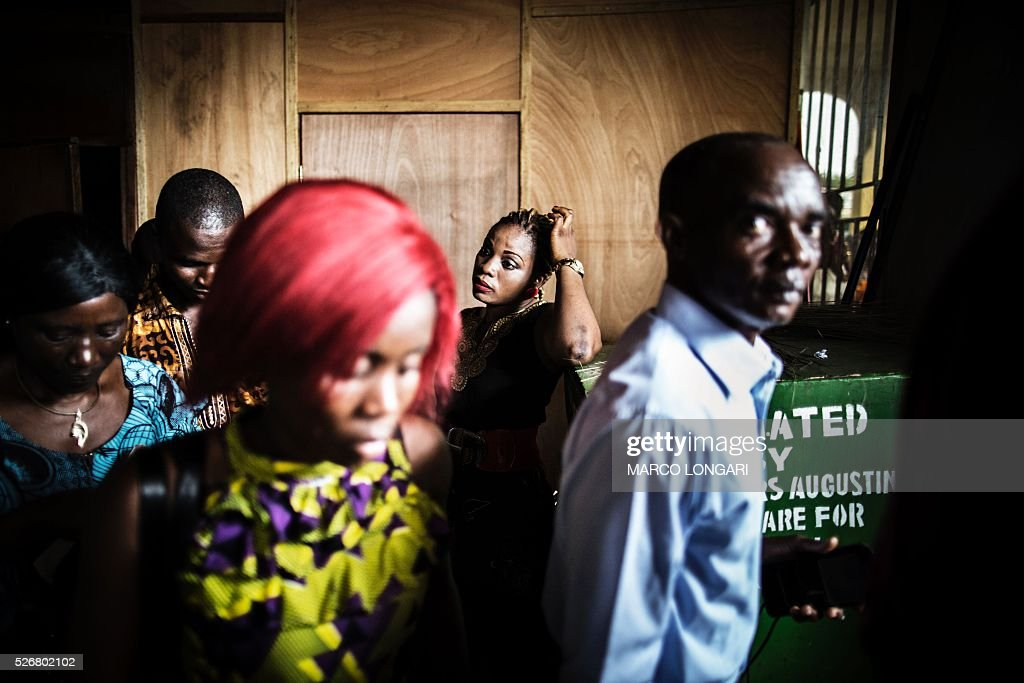 Worshippers leave after the Sunday's service at the Winners Chapel International in the Weasay district of Monrovia on May 1, 2016. / AFP / MARCO
