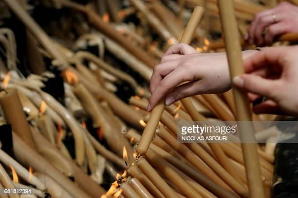 Worshippers lights candles for the Pope at the Fatima Sanctuary 140 km north of Lisbon 01 April 2005 Pope John Paul II received the last rites 31...