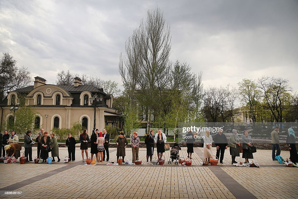 Worshippers line up with food for their Easter meal outside the Holy Transfiguration Cathedral waiting for a blessing from the priest on April 19, 2014 in Donetsk, Ukraine. The church is near the Donetsk Regional Administration Building which has been taken over by pro-Russian activists who have surrounded it with a barricade of tires and barbed wire and are prepared to defend it with caches of Molotov cocktails strategically placed within the barricade. Several bands of activists, similar to those in Donetsk, have taken control and are occupying government buildings in other eastern Ukraine cities in recent weeks.