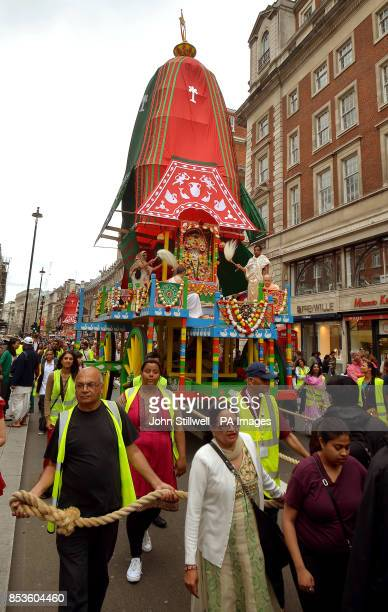 Worshippers make their way down Piccadilly during the Hare Krishna Rathayatra Festival of Chariots central London