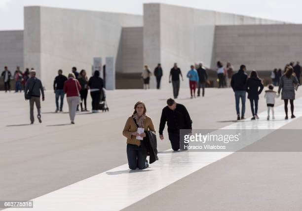 Worshippers move on their knees in the Sanctuary of Fatima on April 1 2017 in Fatima Portugal Thousands of pilgrims and worshippers visit daily the...