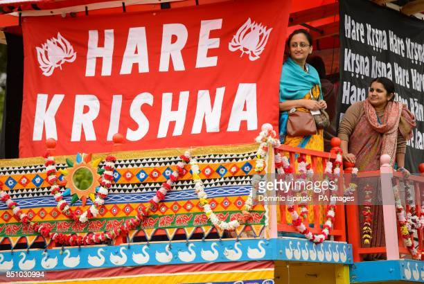 Worshippers on board one of three 40 foot high chariots during the Hare Krishna Rathayatra Festival of Chariots in Hyde Park central London