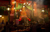 Worshippers pray and carry incense sticks at the Tin Hau Temple in the Yau Ma Tei area of Hong Kong on the fourth day of the Lunar New Year holiday...