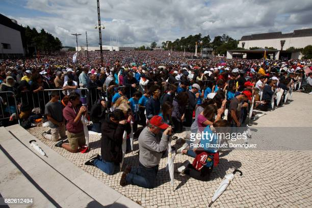Worshippers pray during the ceremony of canonization at the Sanctuary of Fatima on May 13 2017 in Fatima Portugal Pope Francis is attending the...