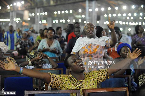 Worshippers pray into the New Year during the crossover watch night church service at the Redemption Camp on Lagos Ibadan highway on Janauary 1 2014...