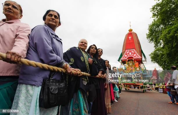 Worshippers prepare to pull one of three 40foot high chariots during the Hare Krishna Rathayatra Festival of Chariots in Hyde Park central London
