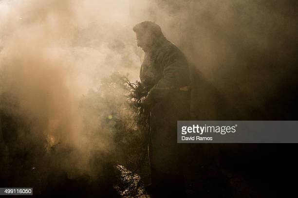 Worshippers take part on the 'Procesion del Humo' on November 29 2015 in Arnedillo Spain Villagers of Arnedillo light bonfires of pine and rosemary...